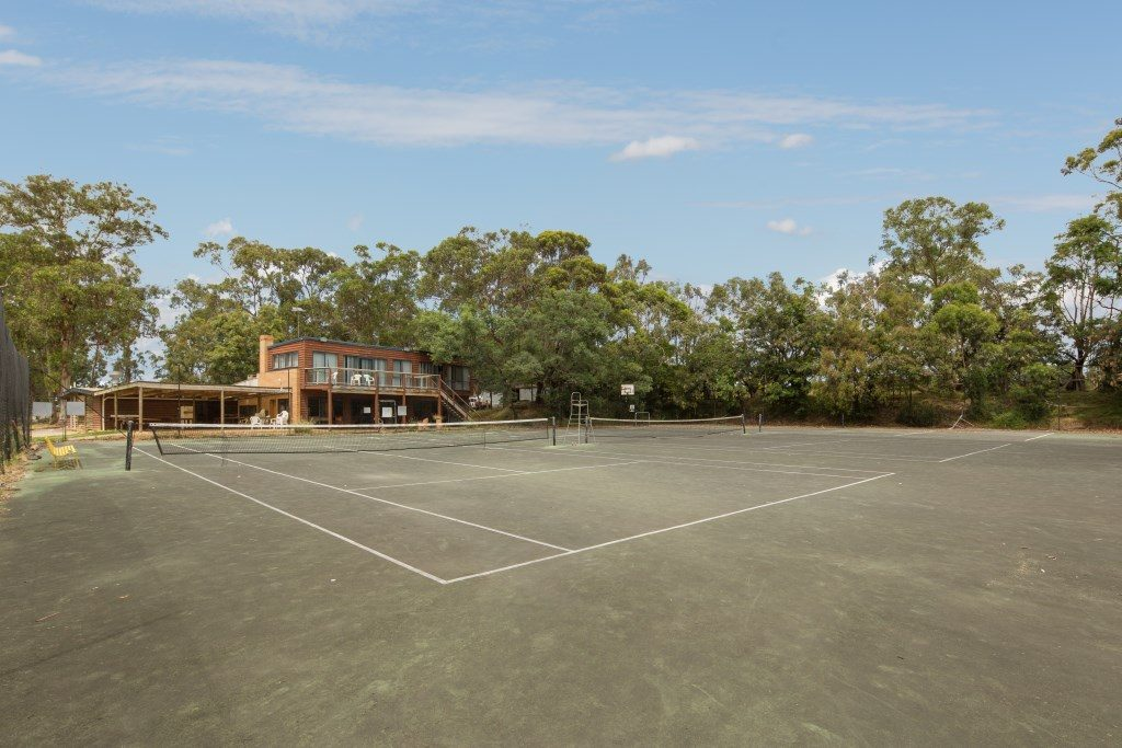Four tennis courts and two basketball courts ideal for large, sporting groups and active families