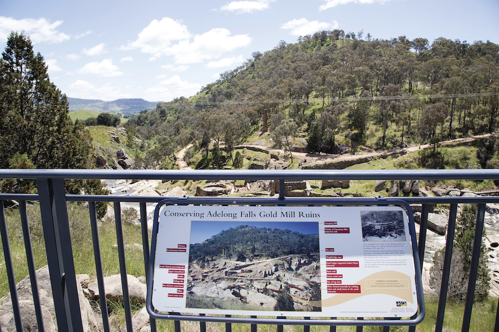 Information panel at the historic site of Adelong Falls Gold Mill Ruins in the scenic country town of Adelong.