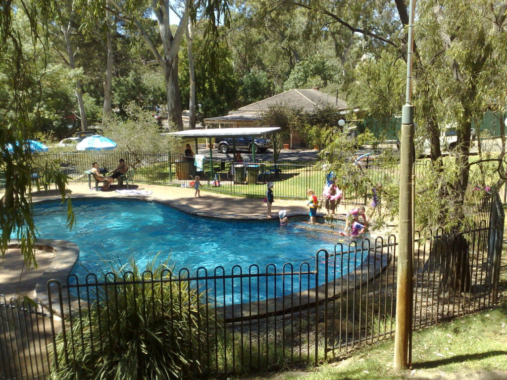 Truly beat the heat in a pool shaded by native forest