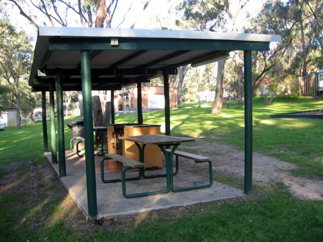 Enjoy a barbecue lunch undercover in the open air at Belair National Park Holiday Park