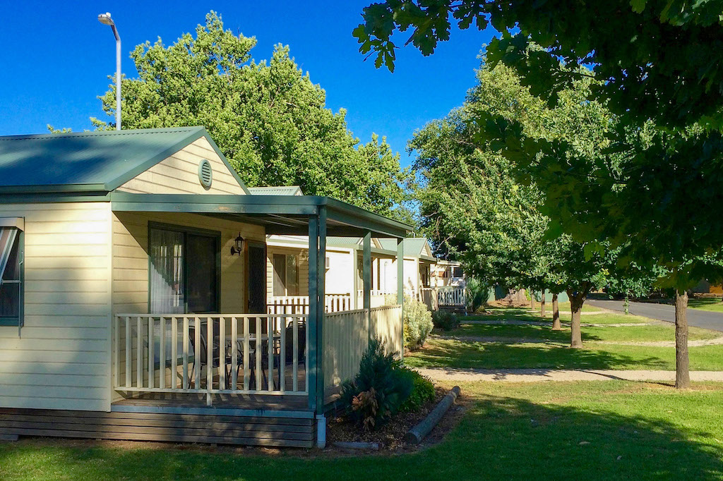 Shaded cabins for ultimate comfort at Lake Anderson Caravan Park in Victoria's beautiful high country