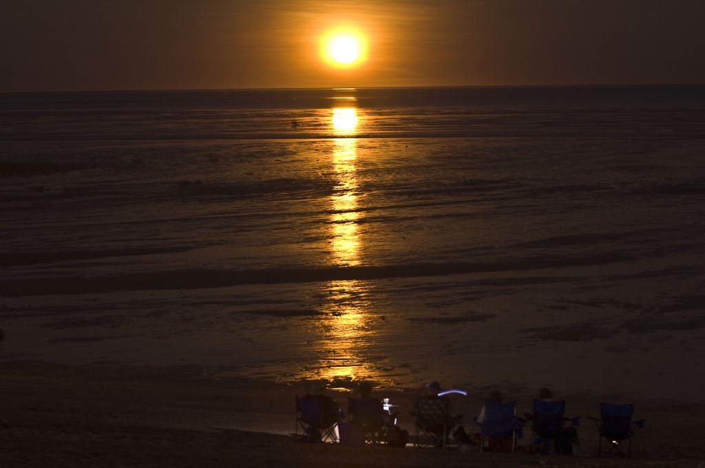 Time your stay by the tides when touring Broome for magic experiences like the moon setting over mudflats at Roebuck Bay