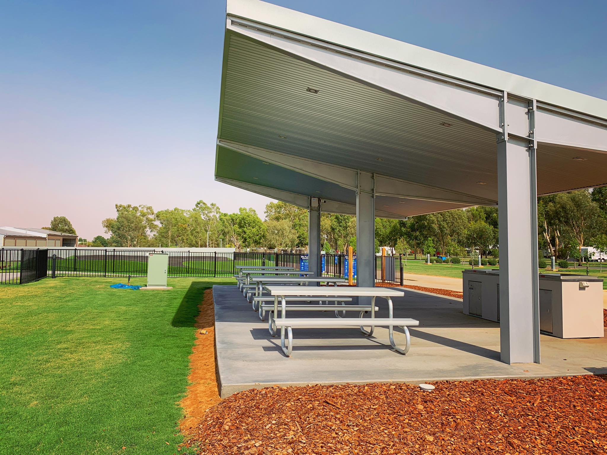 Four stainless steel dinettes sheltered beneath a two-barbecue cooking area at BIG4 Deniliquin Holiday Park