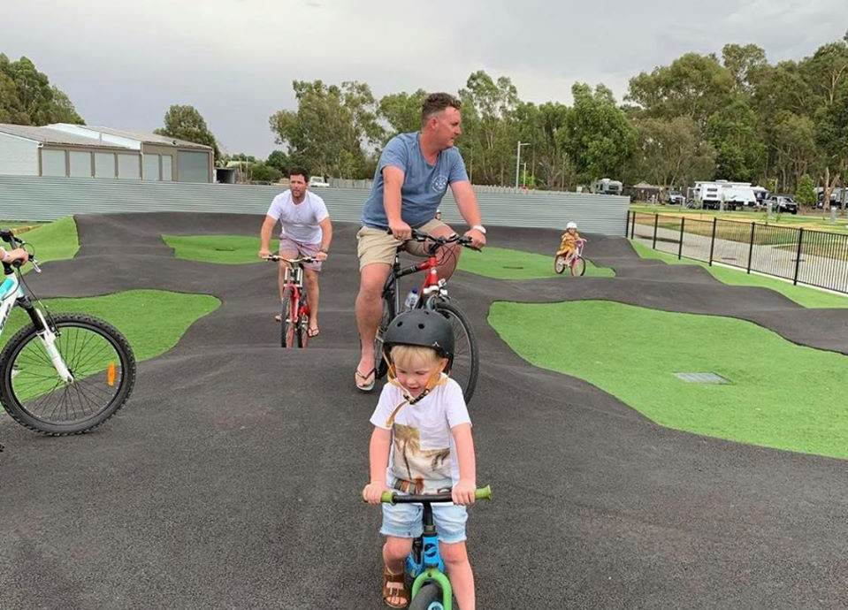 Kids playing on the new pump track at BIG4 Deniliquin Holiday Park