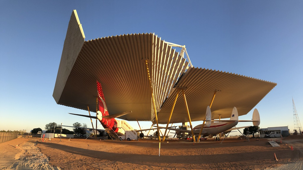 Four restored craft sheltered beneath the Airpark at sunrise at the Qantas Founders Museum