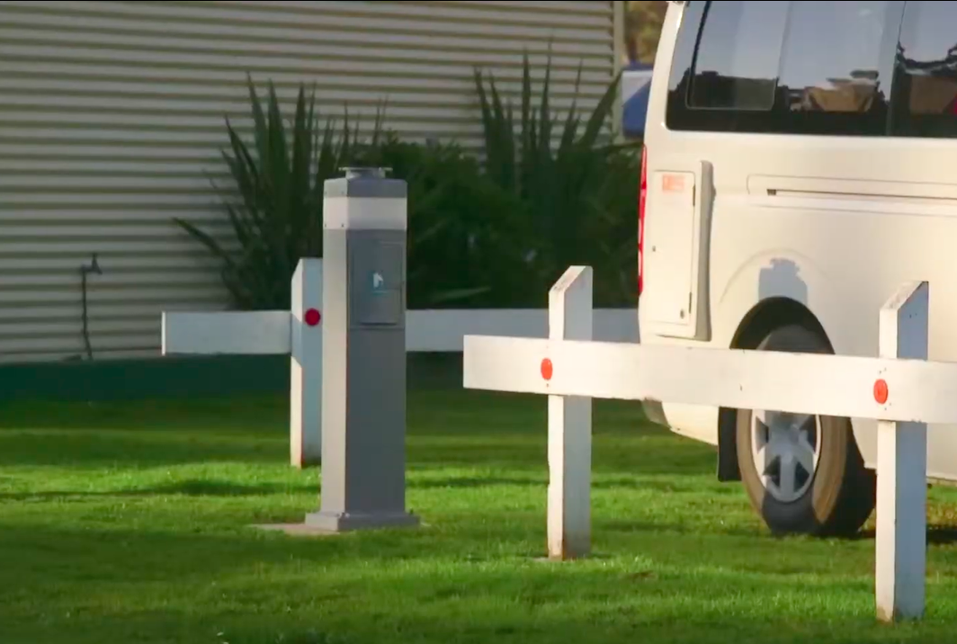 A. modern power pole in a caravan park. The Campers can access up240V power available at