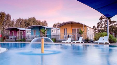 Family-size cabins facing the beautiful water splash park at BIG4 Deniliquin Holiday Park