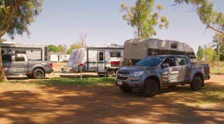 Shelter from the outback heat at a leafy campsite in Lakeview Caravan Park