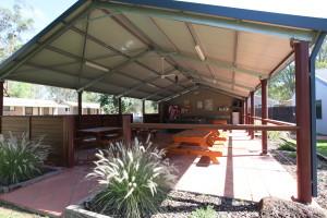 Campers can congregate beneath a sheltered camp kitchen at Deniliquin Riverside Caravan Park