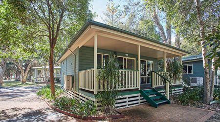 Generous verandah and deck on the Shearwater Cabin at Budgewoi Holiday Park