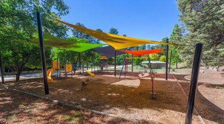 Kids play among nature at the NRMA Bright Holiday Park