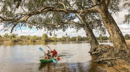 Paddling the gentle waters away from jetskis at Apex RiverBeach Holiday Park, close to Mildura cabins